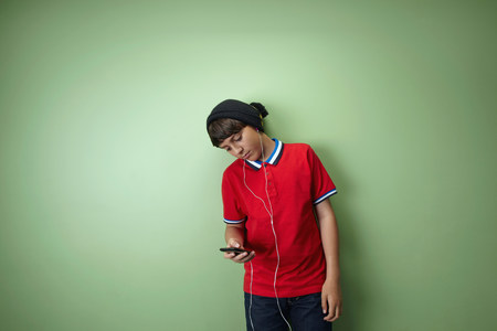 electronic music: Boy listening to mp3 player