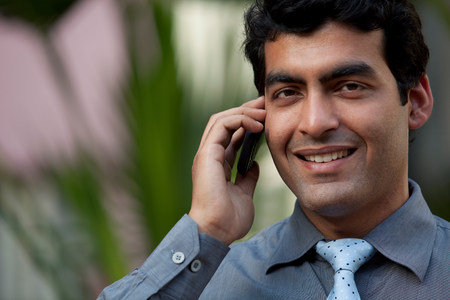 subcontinent: Executive with a mobile phone