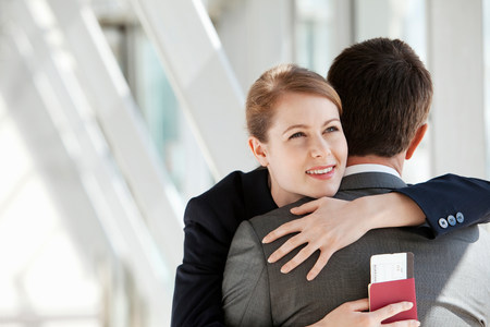 Businesswoman and businessman hugging LANG_EVOIMAGES