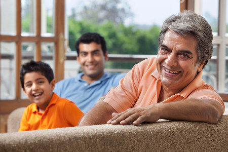 indian subcontinent ethnicity: Portrait of a family on a sofa