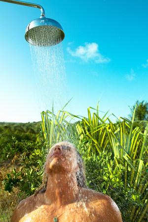 Man enjoying cool shower outdoors