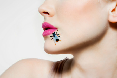 fetishistic: Young woman with plastic fly on face