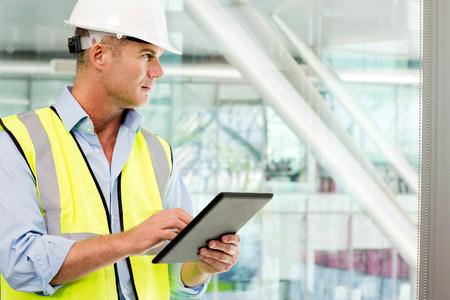 Engineer using digital tablet in office