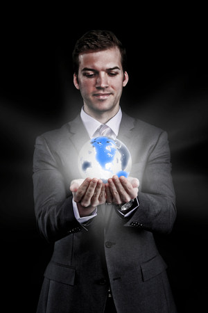 world at your fingertips: Man holding holographic globe