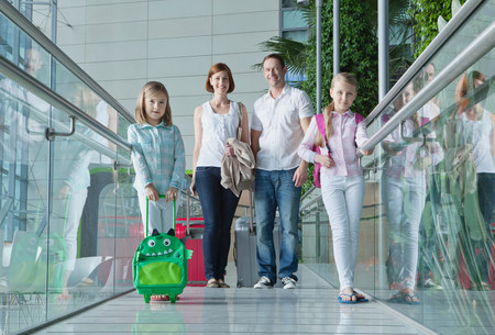 6 7 year old: Family in airport with luggage