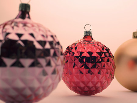 mirroring: Pink and red Christmas baubles