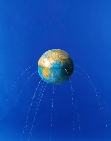 Planet earth with water leaking from it LANG_EVOIMAGES