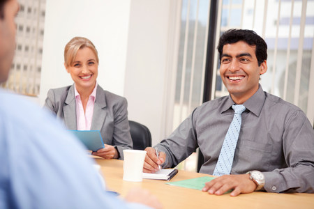 Business executives smiling in a meeting