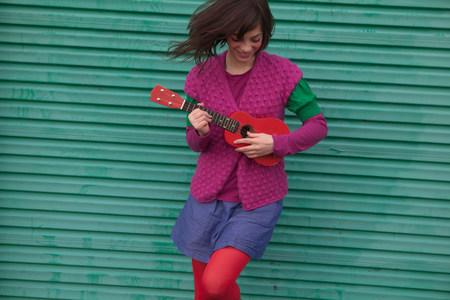 kooky: Young woman playing ukulele
