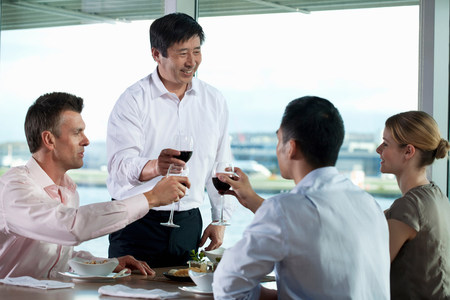 20 25 years old: Multi racial businesspeople toasting wine LANG_EVOIMAGES