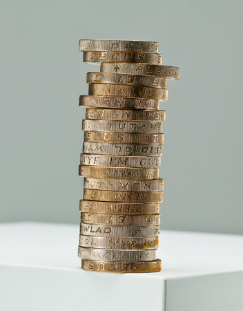 coins shot in golden color: Stack of one pound coins