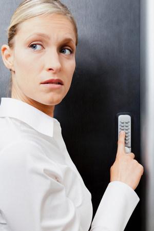 Woman pressing door keypad