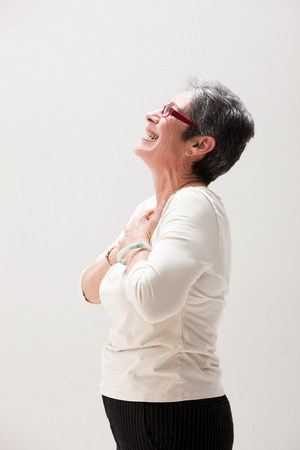 65 69 years: Side view of mature woman smiling,studio shot