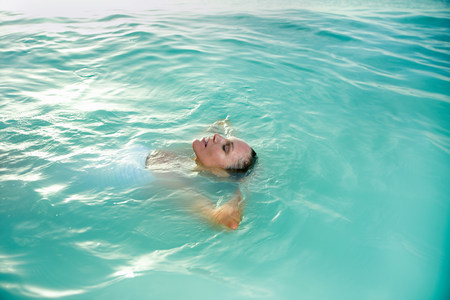 Relaxed woman floating in ocean