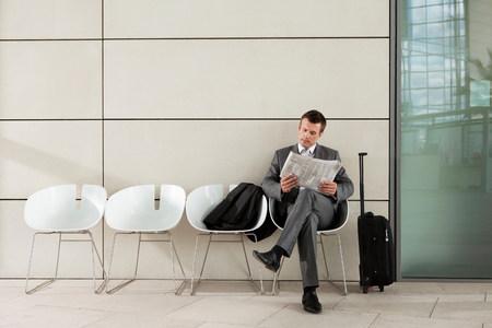 fedup: Businessman reading newspaper