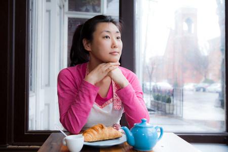 tea breaks: Female cafe owner thinking over breakfast