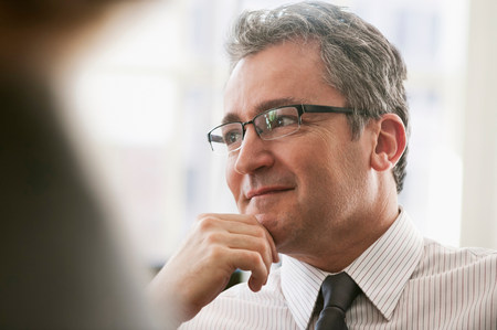 chic woman: Mature businessman looking away and thinking