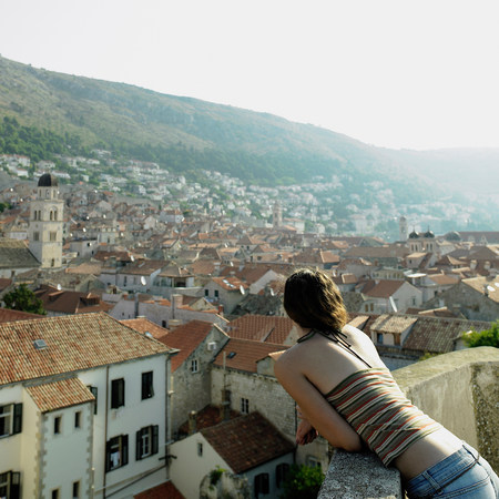 sight seeing: Young woman overlooking Dubrovnik,Croatia