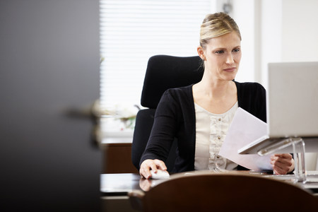 engrossed: Businesswoman working in office
