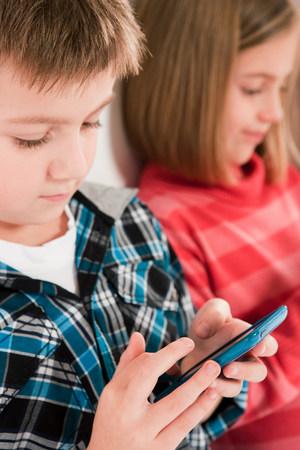 engrossed: Children using smartphones