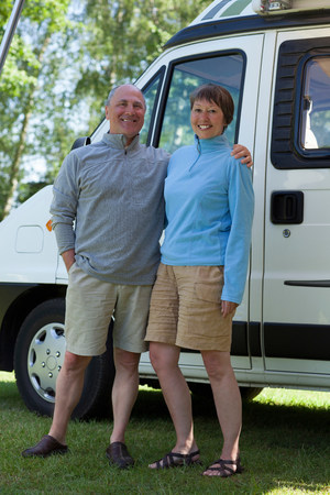60 64 years: Couple outside campervan,portrait
