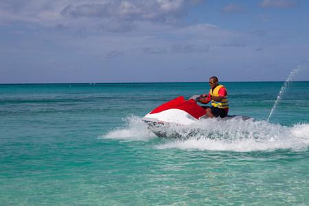 Man jet skiing in Caribbean sea,Grand Cayman,Cayman Islands
