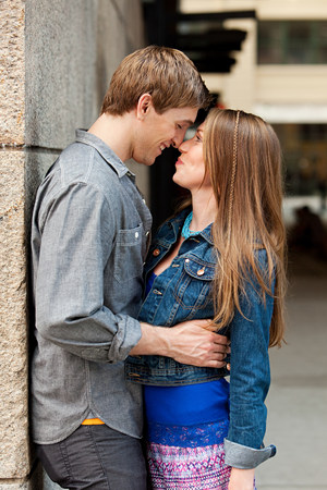 socialise: Young couple kissing outdoors