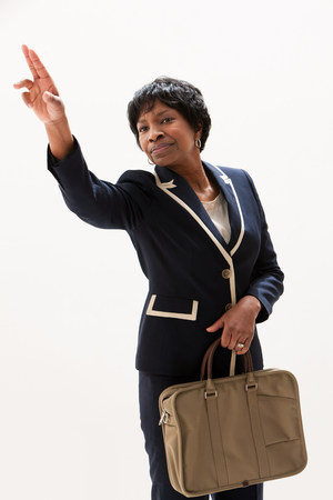Mature African American businesswoman gesturing,studio shot LANG_EVOIMAGES