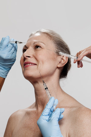 54: Mature woman receiving injections