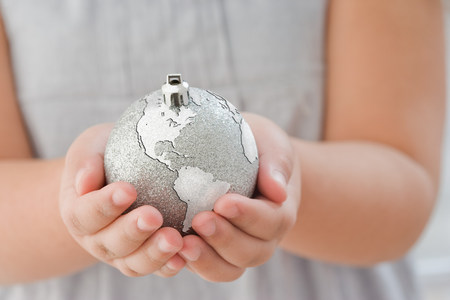 Girl holding a globe decoration