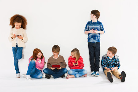Children using different gadgets LANG_EVOIMAGES