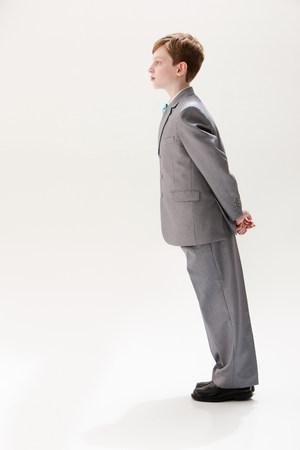 tweens: Boy wearing grey suit,studio shot