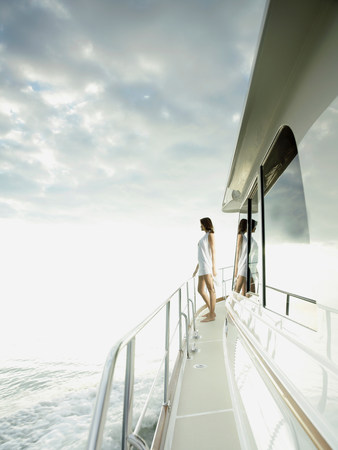 ponderous: Woman standing on yacht LANG_EVOIMAGES