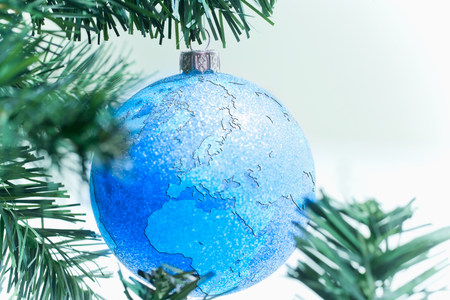 Globe bauble on christmas tree LANG_EVOIMAGES