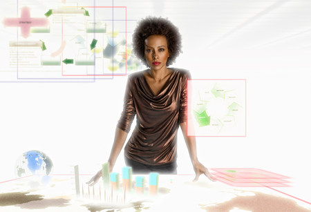 Businesswoman surrounded by holographic objects LANG_EVOIMAGES
