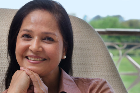 indian subcontinent ethnicity: Portrait of a mature woman smiling