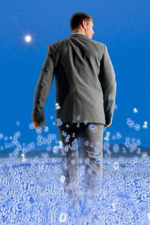 Businessman walking through binary field