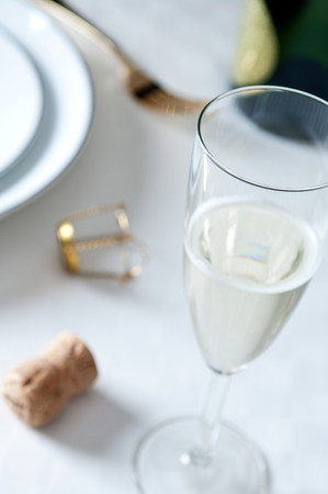 Glass of champagne on table