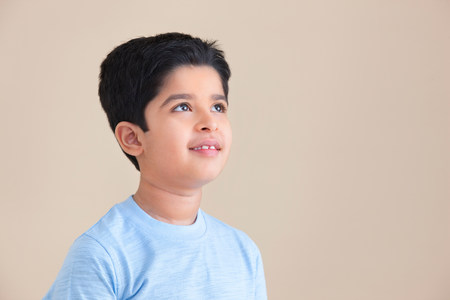 indian subcontinent ethnicity: Young boy looking up