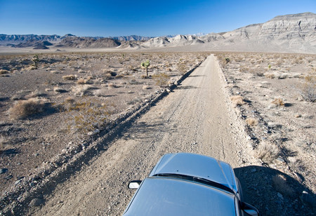 parched: Car on desert road in Death Valley National Park,California,USA