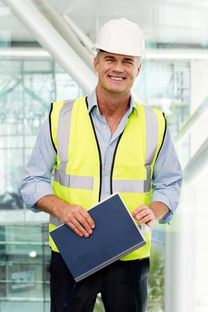 Portrait of engineer wearing hard hat in office LANG_EVOIMAGES