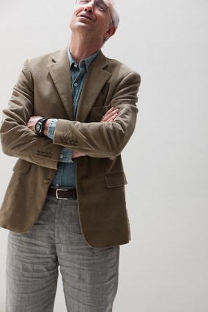ponderous: Mature man looking up and smiling,studio shot