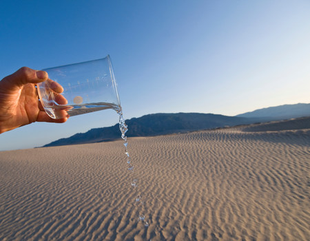 20 25 years old: Man pouring water from beaker in Death Valley National Park,California,USA