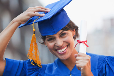 Portrait of mid adult woman graduating,smiling LANG_EVOIMAGES