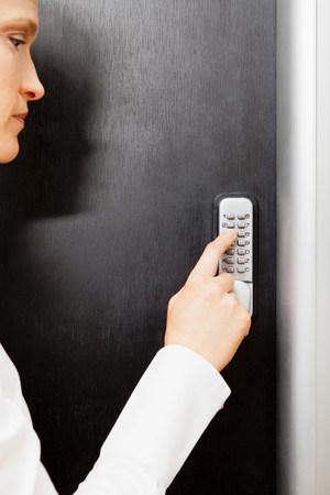 engrossed: Woman pressing door keypad