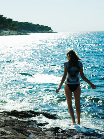 Young woman walking in sea,Dubrovnik,Croatia