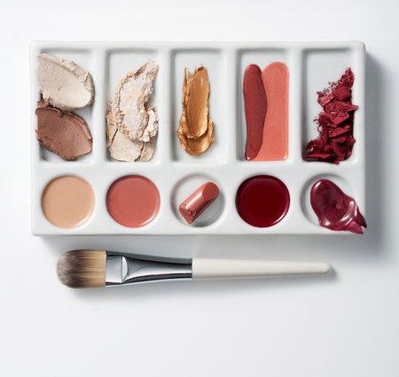 Artists palette with make up and brush