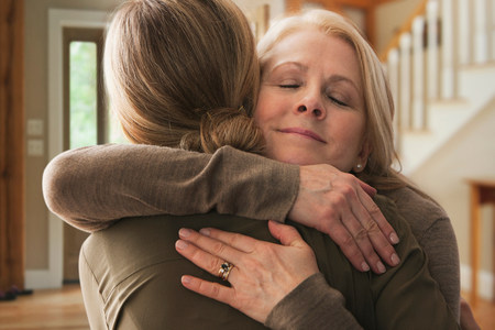 age 25 30 years: Mother embracing adult daughter