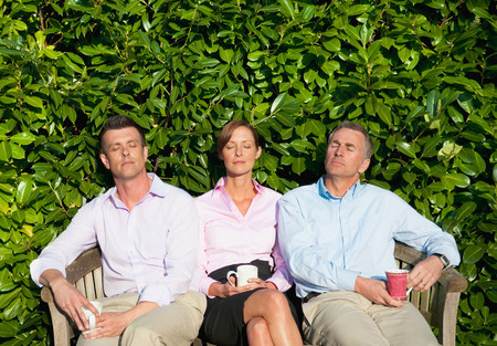 new age: Three businesspeople sitting on bench,asleep LANG_EVOIMAGES
