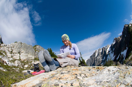 Woman reading map at camp,Picket Pass,North Cascades National Park,Washington State,USA